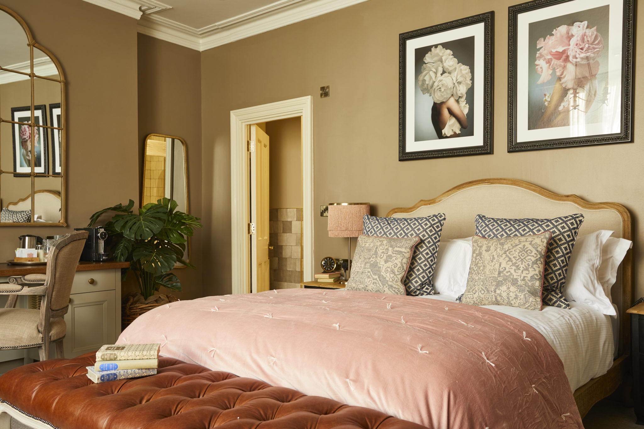 Image of a bedroom interior at the Broad Street Townhouse, Bath, demonstrating artwork installation by Indigo Art Ltd.