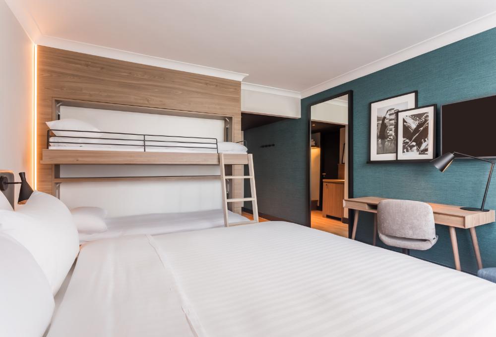 Radisson Heathrow guest bedroom showing layered framed artwork, agreed & supplied by Indigo Art Ltd