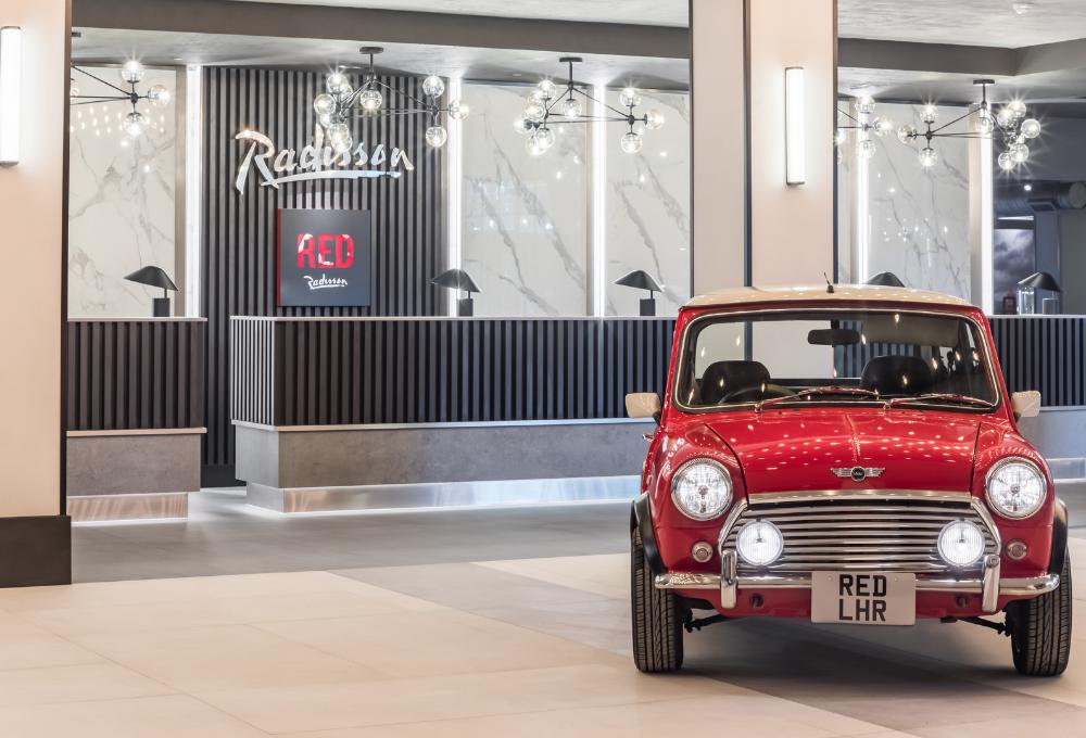 Reception with red mini | Radisson Heathrow